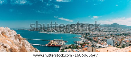 Kusadasi, Aydın Province, Turkey. Waterfront And Kusadasi Cityscape In Sunny Summer Day. Scenic View Of Kusadasi Skyline At Aegean Coast, Turkey. Panorama, Panoramic View. #1606065649