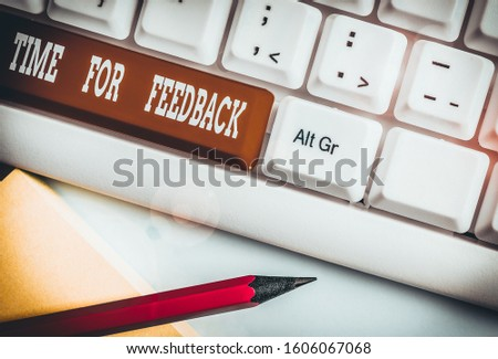 Text sign showing Time For Feedback. Conceptual photo information about reactions to a product or services White pc keyboard with empty note paper above white background key copy space. #1606067068