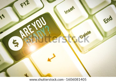 Text sign showing Are You Ready Question. Conceptual photo used telling someone start something when feel prepared White pc keyboard with empty note paper above white background key copy space. #1606081405