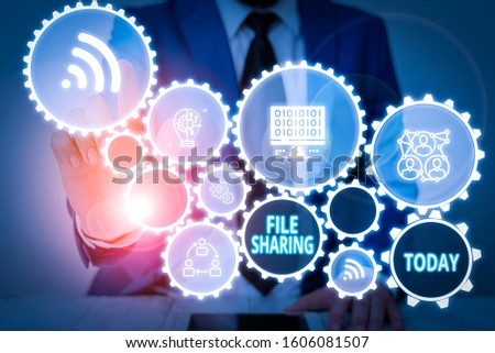 Writing note showing File Sharing. Business photo showcasing transmit files from one computer to another over a network Male wear formal work suit presenting presentation smart device. #1606081507