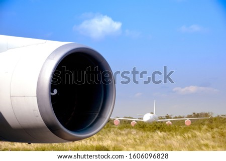 Aircraft (airplane) running jet engine after maintenance. Jet engine blowing dust in the wind while engine running. #1606096828