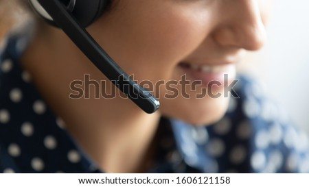 Telesales agent wear wireless headset microphone consult customer support service on phone call center concept, business woman operator receptionist telephone assistant representative close up view #1606121158