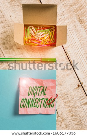 Conceptual hand writing showing Digital Connections. Business photo text the online way to explore and build relationships Wrinkle paper and cardboard placed above wooden background. #1606177036