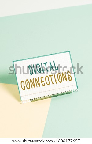 Text sign showing Digital Connections. Conceptual photo the online way to explore and build relationships Paper placed tilted above buffer wire on soft pastel multi colours backdrop. #1606177657