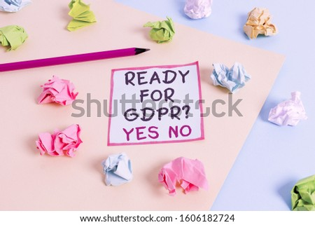 Word writing text Ready For Gdpr question Yes No. Business concept for Readiness General Data Protection Regulation Colored crumpled papers empty reminder blue yellow background clothespin. #1606182724