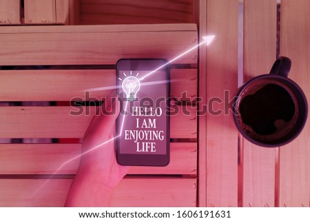 Conceptual hand writing showing Hello I Am Enjoying Life. Business photo text Happy relaxed lifestyle Enjoy simple things. #1606191631