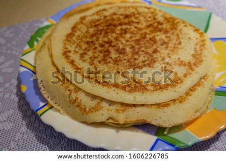 A stack of pancakes cooked at home. On the plate. #1606226785