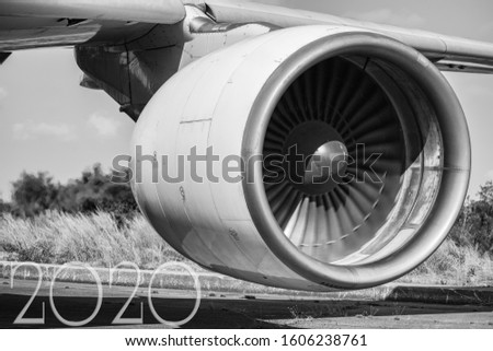 Aircraft (airplane) running jet engine after maintenance with letter 2020in picture.