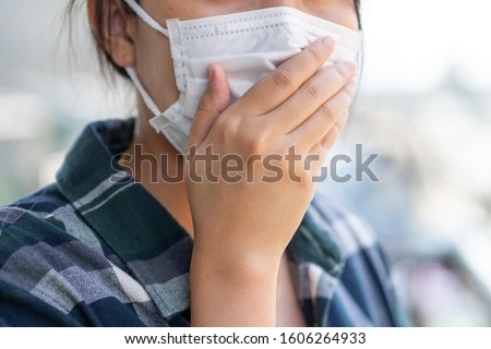 Woman wearing face mask protect filter against air pollution (PM2.5) or wear N95 mask. protect pollution, anti smog and viruses, Air pollution caused health problem. environmental pollution concept. #1606264933