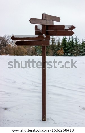 Winter wooden sign pointers with a space for happy place text. On white background with clipping path. #1606268413
