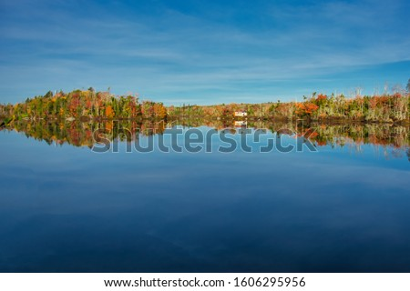 fall colors and reflections on lake in Nova Scotia