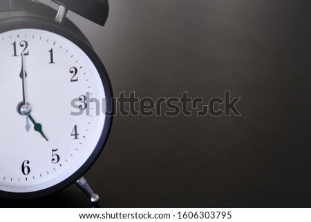 Vintage clocks placed on a black table with space for placing things in the morning. #1606303795