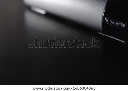 Black speaker placed on a black table with space for placing things in the morning. #1606304365