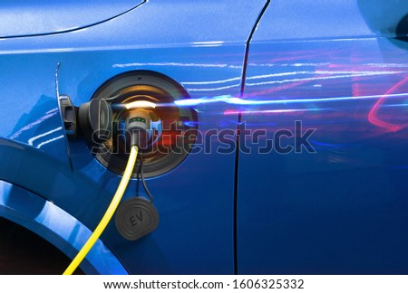 Power supply connect to electric vehicle for charge to the battery. Charging technology industry transport which are the futuristic of the Automobile. EV fuel Plug in hybrid car. #1606325332