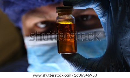 Laboratory worker scientist laboratory assistant tests chemicals for reactions in flask, interfering with different substances and obtaining a visual reaction. Concept of: Science, Chemistry. #1606346950