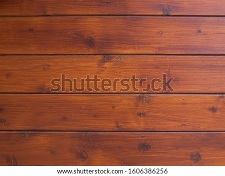 Wood-paneled wall, close-up. The wooden panelling is arranged horizontally.  #1606386256