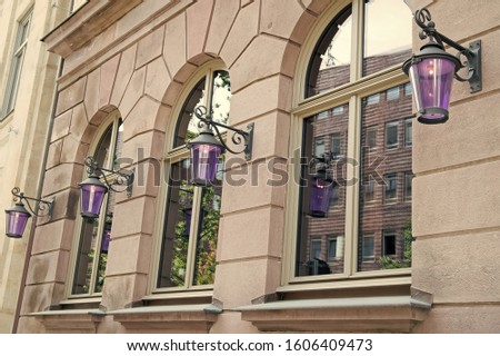 Wanderlust and city dust. Old building architecture. House facade with windows and lanterns. Architectural structure. Building and architecture. Town architecture. Architecture and urban development. #1606409473
