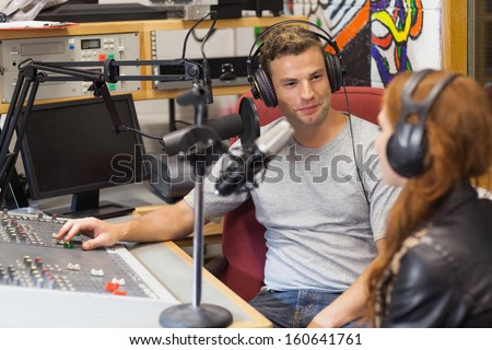 Attractive content radio host interviewing a guest in studio at college #160641761