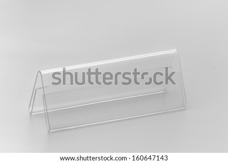 Acrylic card holder for events. Isolated transparent object with white background.
