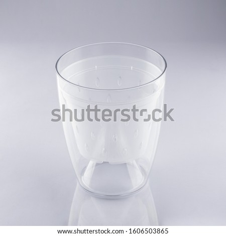 transparent acrylic pot for Orchid flower on grey background #1606503865