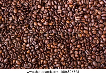background of coffee beans. top view of coffee beans texture #1606526698