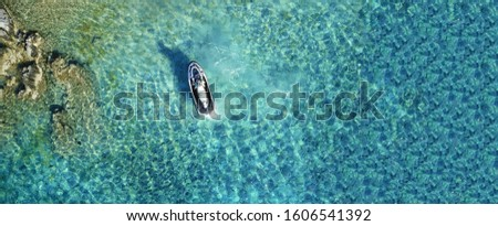 Aerial drone ultra wide top down photo of jet ski docked in tropical exotic beach