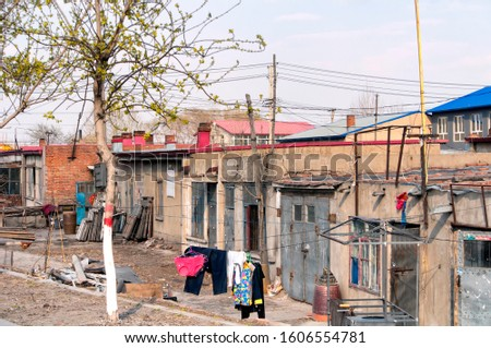 Weathered old houses exteriors in Zhaodong China in Heilongjiang Province on a sunny day. #1606554781