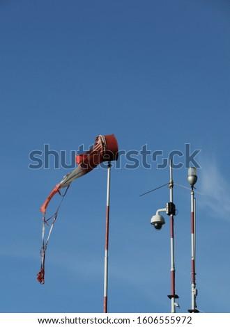 Wind vane anemometer with blue sky #1606555972
