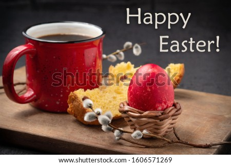 Red Easter egg, slice of Easter cake, cup of coffee on a cutting board on a dark table and inscription Happy Easter - greeting card