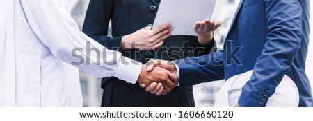 Successful businessmen handshake partner with arab businessman.Partnership approval and thanks gesture concept #1606660120