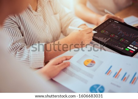 Stock exchange market concept, businessman trader and team looking on tablet with graphs analysis candle line in office room, diagrams on screen. #1606683031