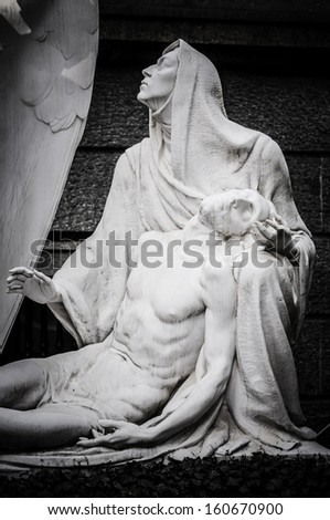 jesus christ and virgin mary statue in the cemetery #160670900