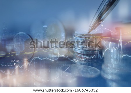 finance background, stock market analysis, business and investment concept. Double exposure of row of coins and the city with financial graph on virtual screen. #1606745332