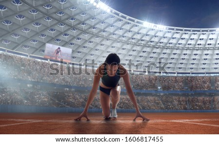 Female athletes sprinting. Women in sport clothes on starting line prepares to run at the running track in professional  athletics stadium. #1606817455