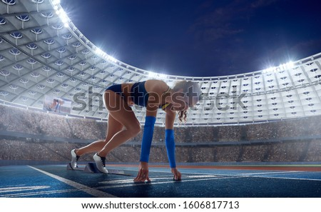 Female athletes sprinting. Women in sport clothes on starting line prepares to run at the running track in professional  athletics stadium. #1606817713