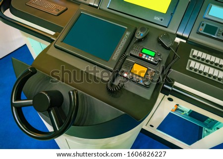 Captain's bridge on a yacht. Steering wheel. Concept - boat control. Radio station. Steering wheel for yacht control. Radio communication on the ship. Professional ship radio station. Communication #1606826227