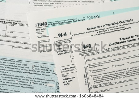 Paper blanks of 1040, w4 and w9 tax form close up #1606848484