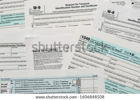 Paper blanks of 1040, w4 and w9 tax form close up #1606848508