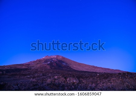 Spain, Tenerife, Starry sky and moonlight shining on snowy peak of volcano mountain teide late in the night #1606859047