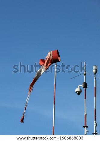 Wind vane anemometer with blue sky #1606868803