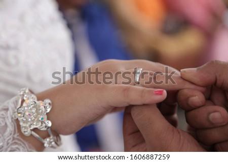 Cincin kawin or wedding ring in Indonesian wedding ceremony. #1606887259