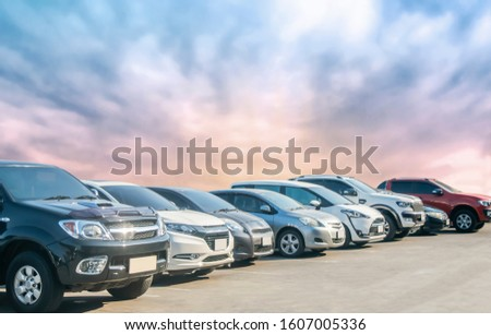 Car parking in asphalt parking lot with beautiful sky background. Outdoor parking lot with nature fresh ozone and green environment of travel transportation business concept #1607005336