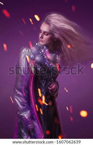 Beautiful woman in fashion look with purple background #1607062639
