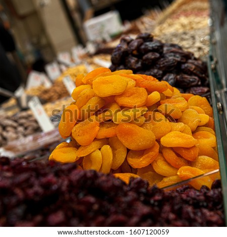 Mix of dried and sun-dried fruits, dried fruits in a wooden box on a white wooden background. View from above. Symbols of the Jewish holiday of Tu B'Shvat #1607120059