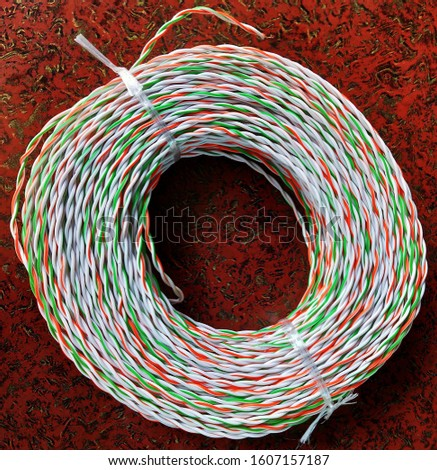 Colored wires and cables in electrical. Bundle of telecommunication multicolored cable in brown color background #1607157187