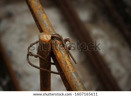 Reinforcing steel rod for construction, construction work.Reinforcing steel rods with wire rod are used on the construction site.The use of steel wire for fixing steel rods with wire rods. #1607165611