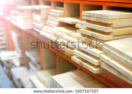 Shelves with lumber and wooden boards. Building warehouse.  #1607167507