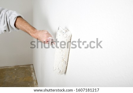Coseup of painting a wall while renovating #1607181217