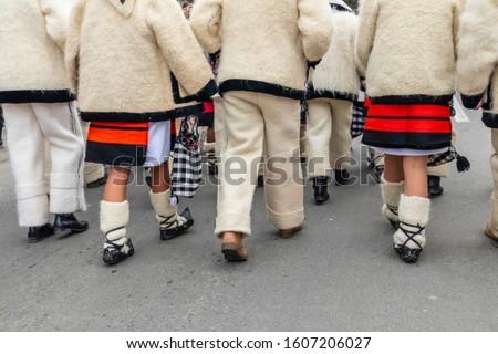 Sighetu Marmatiei, Romania: Maramures traditional costumes. Traditional Romanian peasant sandals which is worn with the Romanian peasant costume at Winter Customs and Traditions Marmatia Festival #1607206027
