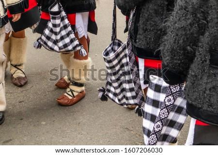 Sighetu Marmatiei, Romania: Maramures traditional costumes. Traditional Romanian peasant sandals which is worn with the Romanian peasant costume at Winter Customs and Traditions Marmatia Festival #1607206030